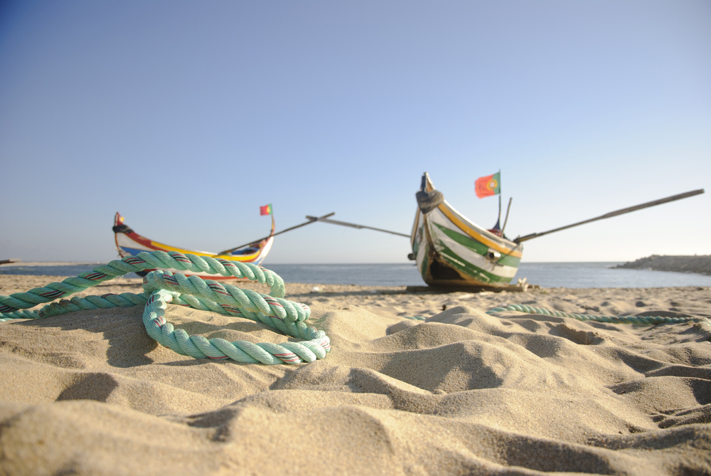 Typical old portuguese fishing boats with rope infront on the beach of Espinho Portugal8