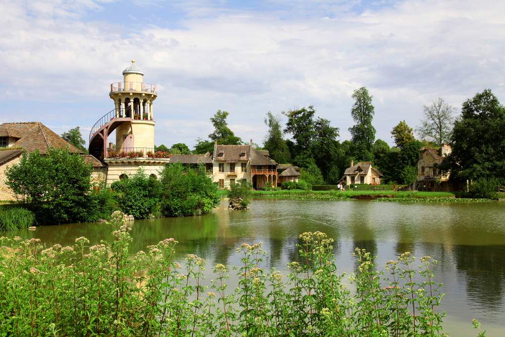 VERSAILLES JULY 11 Cottage and Marlborough Tower at Marie Antoinettes Little Hamlet rustic retreat in the park of the Palace of Versailles near the Petit Trianon on J 1