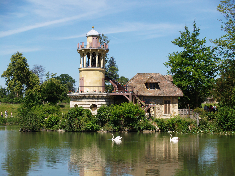 VERSAILLES JULY 11 Cottage and Marlborough Tower at Marie Antoinettes Little Hamlet rustic retreat in the park of the Palace of Versailles near the Petit Trianon on J