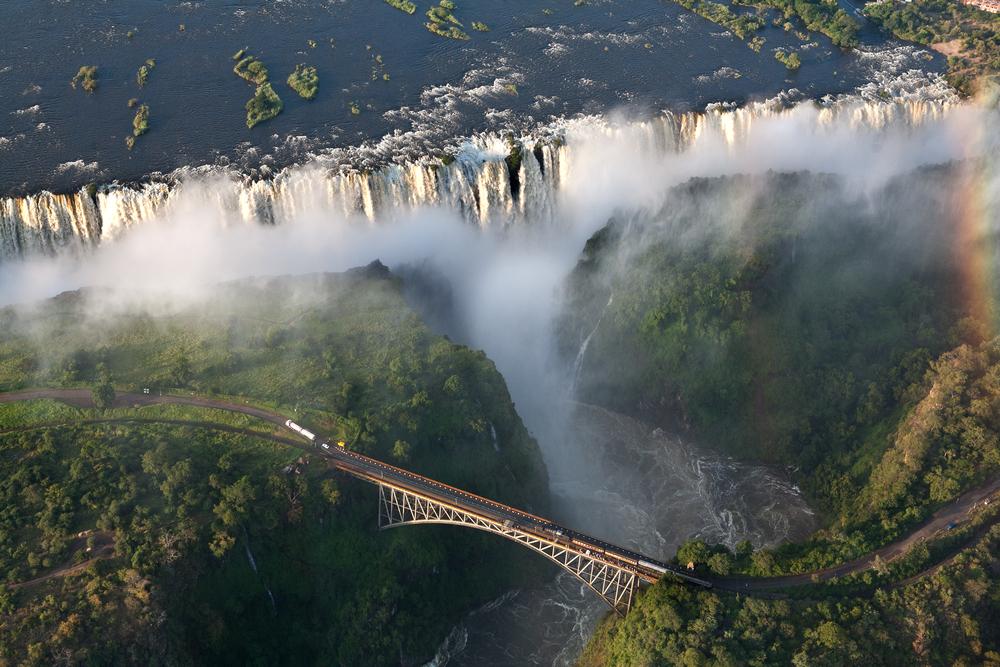 Victoria Falls sunset with rainbow Zambia