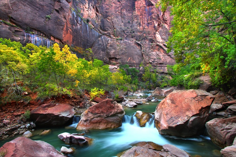 Virgin River flows through large boulders in Zion Canyon