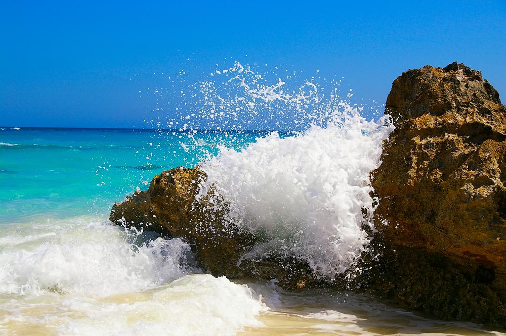 Water splashing against ocean Bermuda rocks