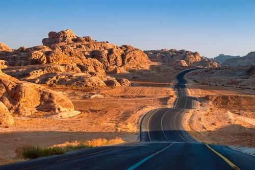 Winding desert road in Wadi Rum Jordan