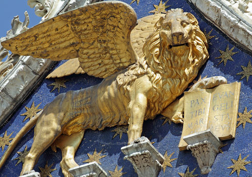 Winged Lion symbol of St Mark with book quoting Pax Tibi Marce Evangelista Meus Peace to you Mark my evangelist detail from the facade of San Marco Basilica in V