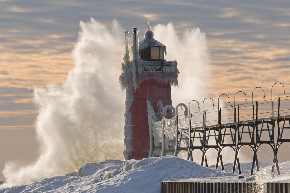 Winter South Haven Michigan Lighthouse with crashing wave Lake Michigan USA