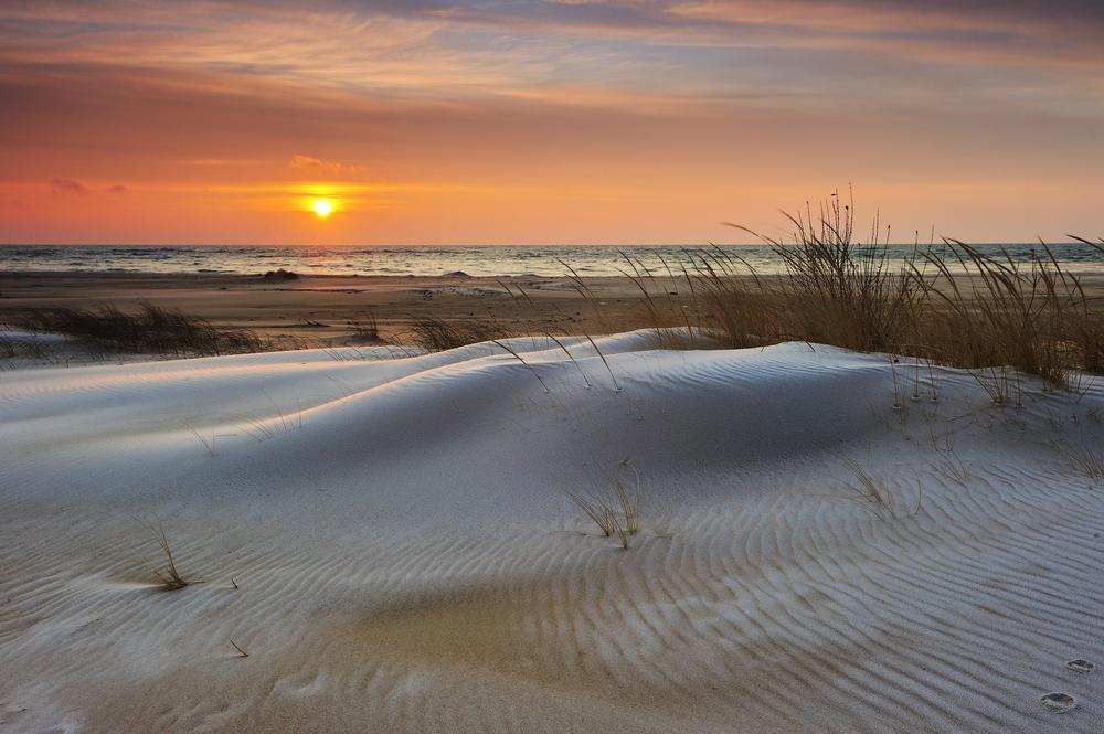 Winter sunrise on Lake Huron Tawas State Park Michigan USA