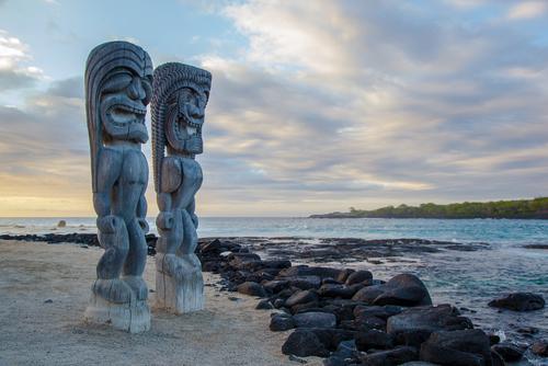 Wooden Hawaiian statues in Puauhonua o Honaunau National Historical Park Big Island Hawaii