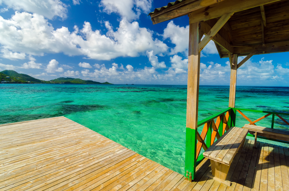 Wooden dock in Caribbean sea with beautiful turquoise and blue water in San Andres y Providencia Colombia