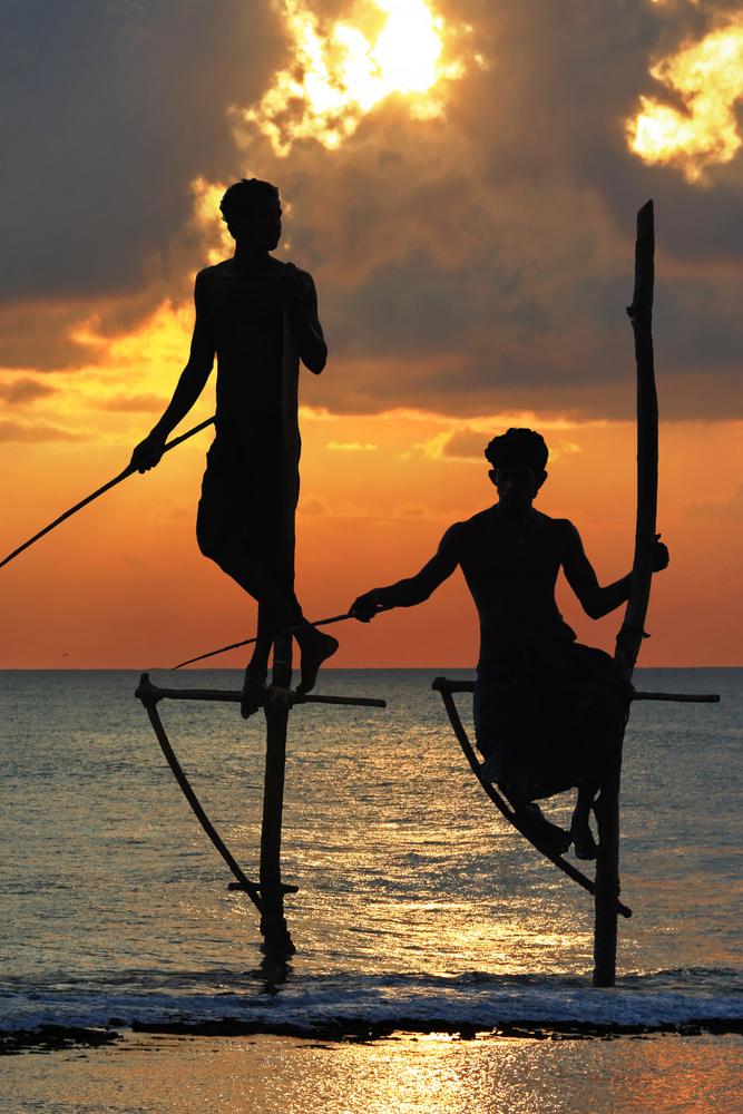 amazing sunset in Sri lanka with traditional stick fishermen7
