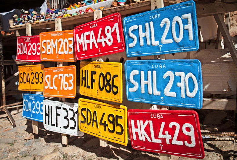 ditional handcrafted vehicle registration plates like souvenirs for sale in Trinidad Cuba