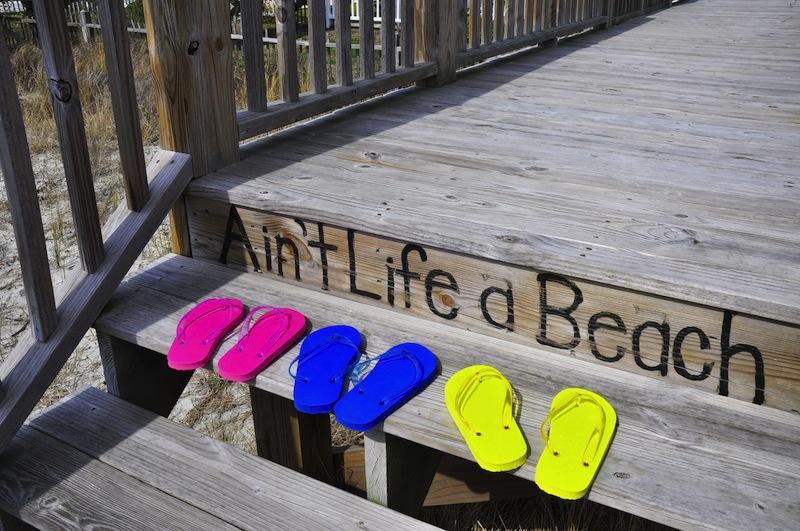 flops on a beach boardwalk
