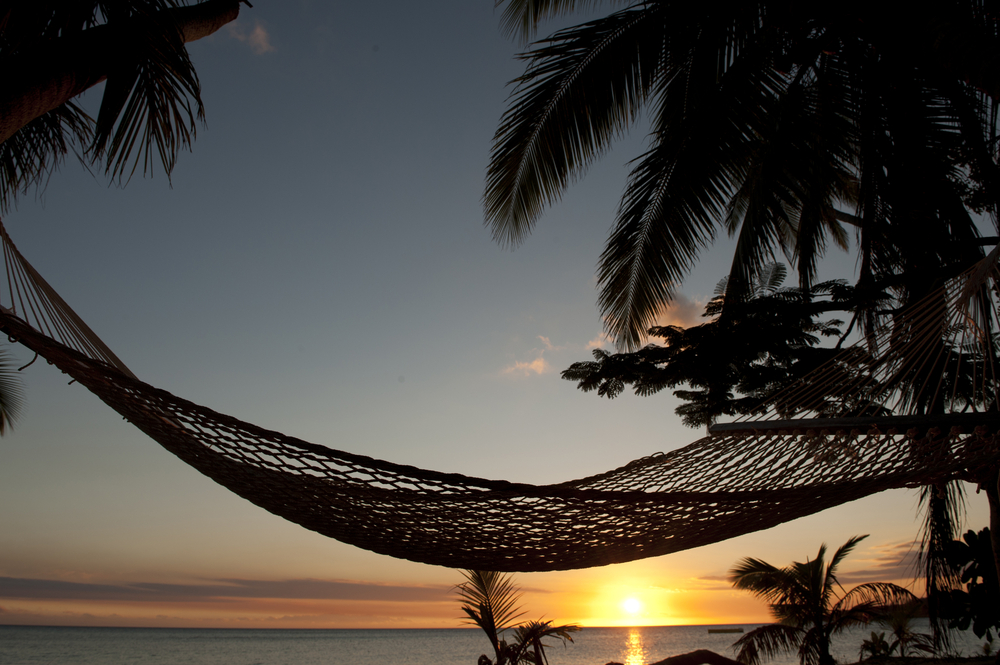 hammock on beach at sunset in Fiji Islands
