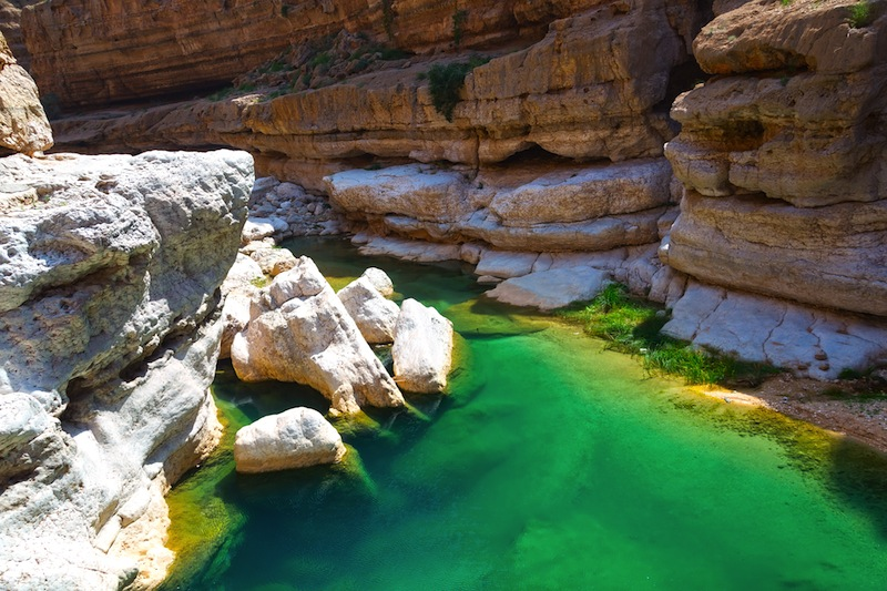 he Wadi Shab with emerald green water one of the most famous and amazing wadi valley in Oman