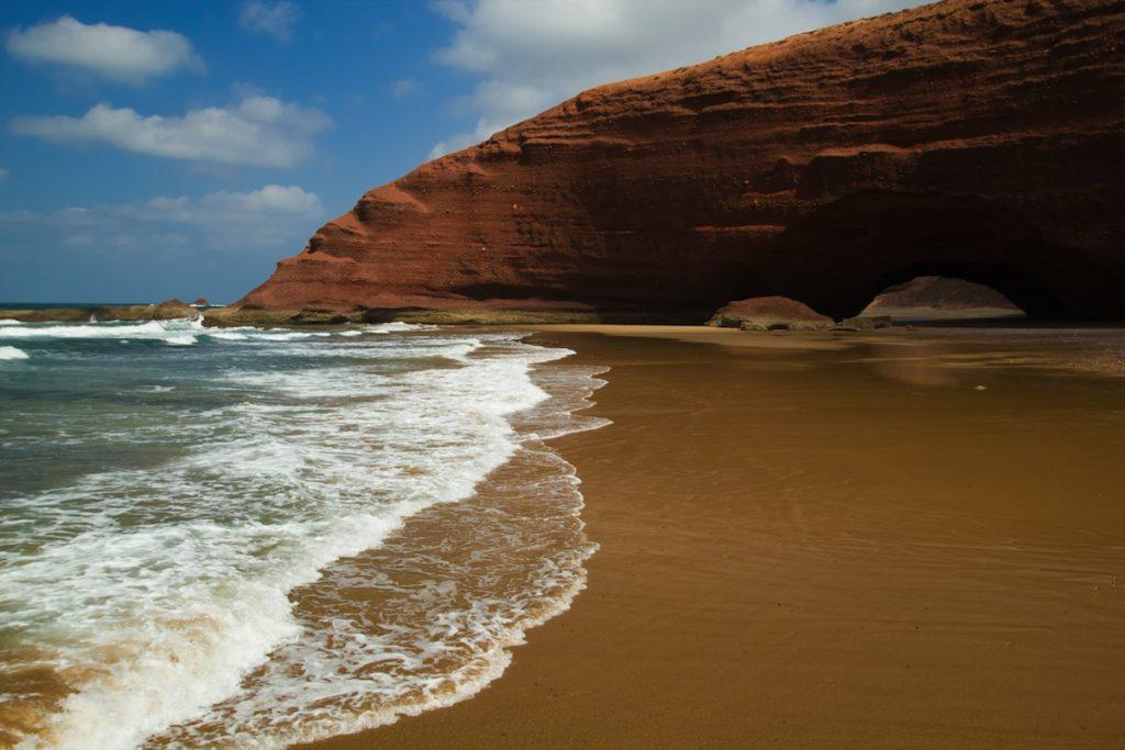 huge red cliffs on the beach Legzira