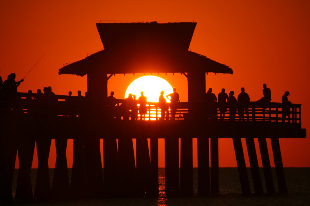 sunset at the pier in Naples Florida soft focus