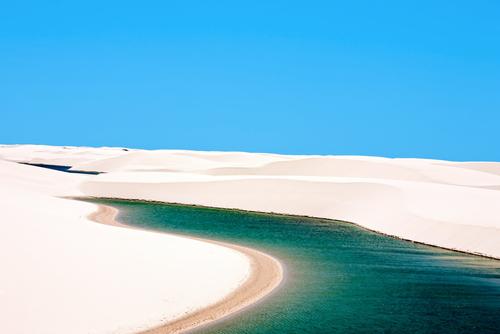 view of lagoa azul in desert white sand dunes of the Lencois Maranheses National Park in brazil 66