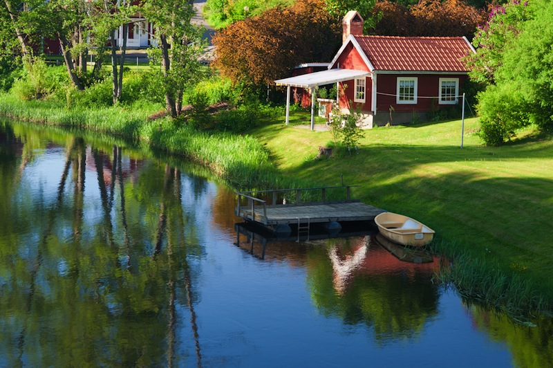 village Hoegsby Swedenin the foreground the river Eman