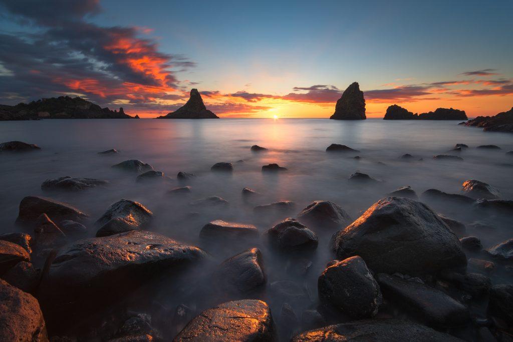 beautiful dawn sea stacks acitrezza